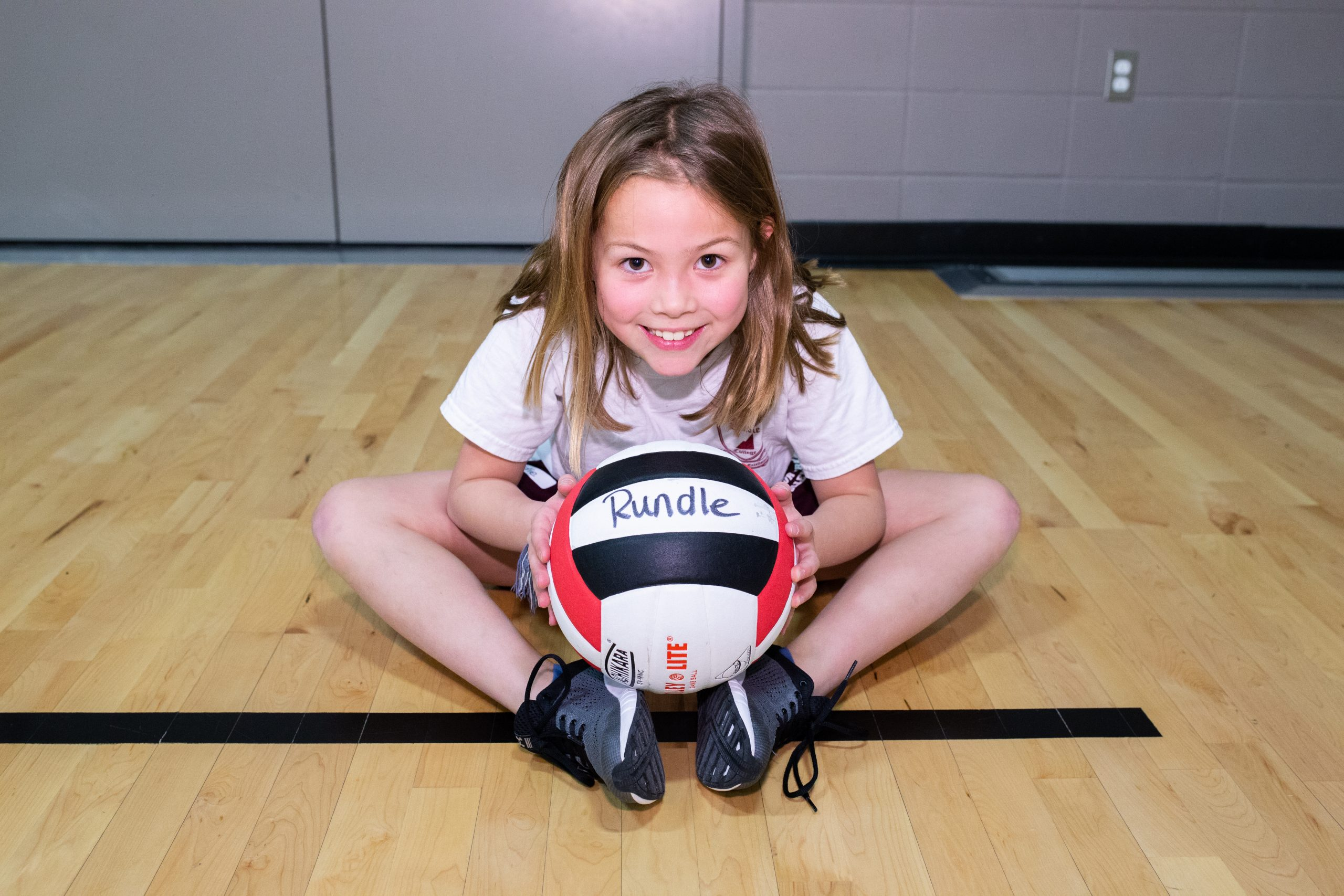Jr. Cobras - girl playing with volleyball