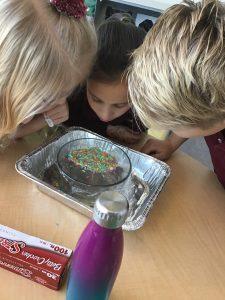 Curiosity Lab - kids doing an experiment