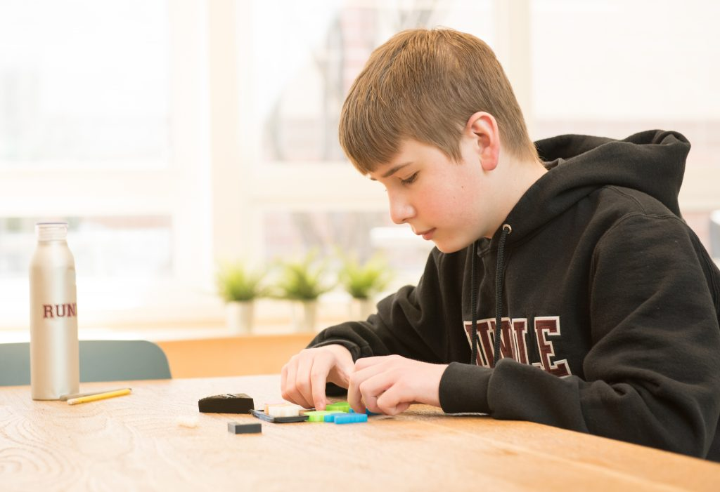 boy putting together a puzzle