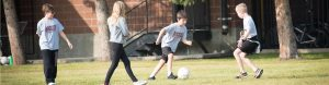 Image of students playing soccer